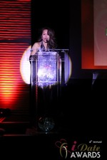 Carmelia Ray announcing Best Up and Coming Dating Site at the 2013 iDate Awards Ceremony